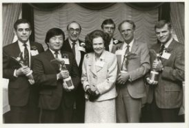 Lee Hood (far right), recipient of a 1987 Lasker Basic Medical Research Award. Other award recipients: Philip Leder (left), Susumu Tonegawa, and Mogens Schou (next to Dr. Hood). Mary Lasker is in the center. Behind her are Michael DeBakey, who was then Chair of the Lasker Awards Jury, and James Fordyce, a member of the Foundation's Board of Directors.