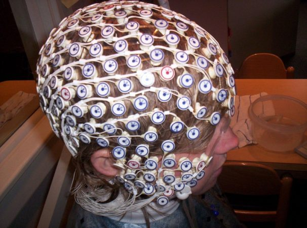 Brain researcher Dennis Molfese places a net of 256 electrodes over an athlete's head to track brain activity before and after a concussion. The electrodes pinpoint which regions of the brain are most active during tests of attention and memory. Credit: Courtesy of Dennis Molfese