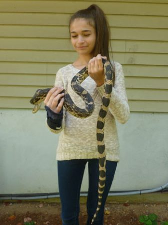 Gianna Fantell holding a snake