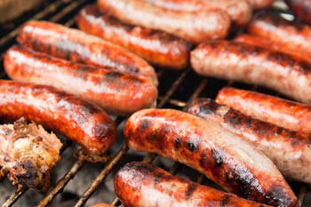 brats on a grill