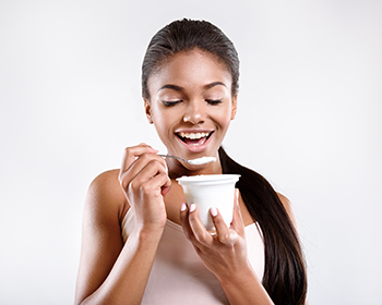350_girl_eating_yogurt.png