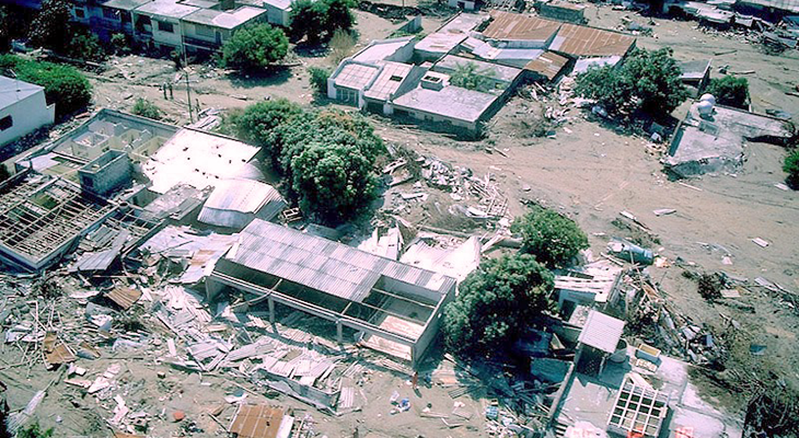 an aerial photo of the town of Armero in Colombia showing the only buildings left standing after a lahar.