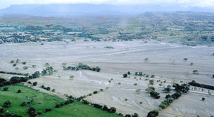 an aerial photo of where the Columbian town of Armero used to stand, covered in mud and ash