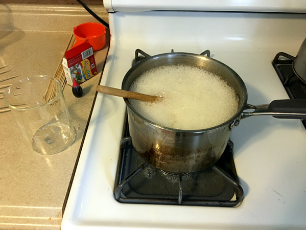 a photo of sugar boiling on a stovetop