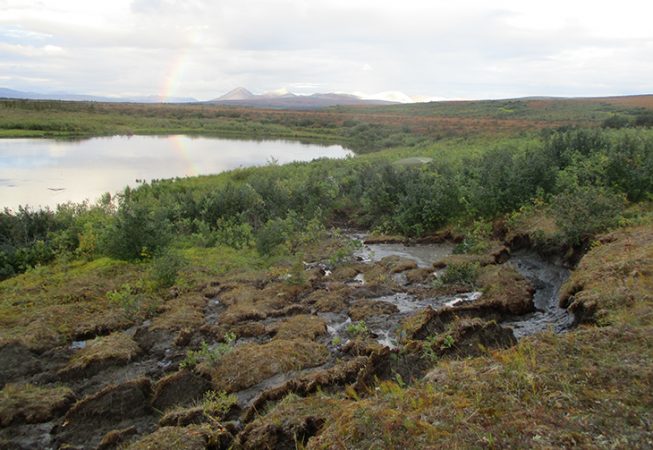 730_thawing_permafrost_hill_rainbow_methane.png