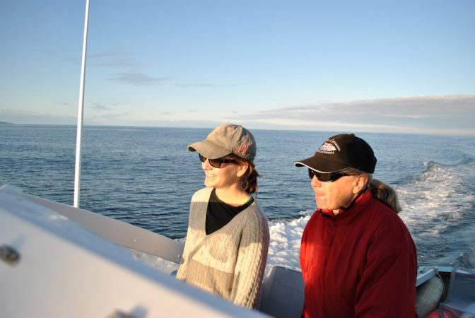 "Moira ""Moe"" Brown (right) and Marianna Hagbloom, both biologists with the New England Aquarium, pilot the R/V Nereid out to the Bay of Fundy. Credit: Eric Wagner"