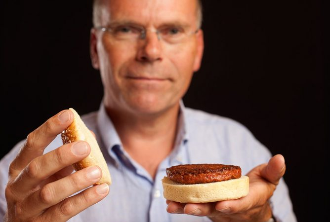 Mark Post holds a cooked cultured hamburger. Credit: David Parry / PA Wire