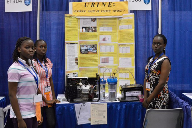 Adebola Duro-Aina (left), Oluwatoyin Faleke (center) and Zainab Bello (right) designed a system that uses urine to produce a fuel. Generators that run on this fuel, rather than gasoline, would avoid spewing carbon monoxide, a toxic pollutant. Credit: Patrick Thornton, SSP
