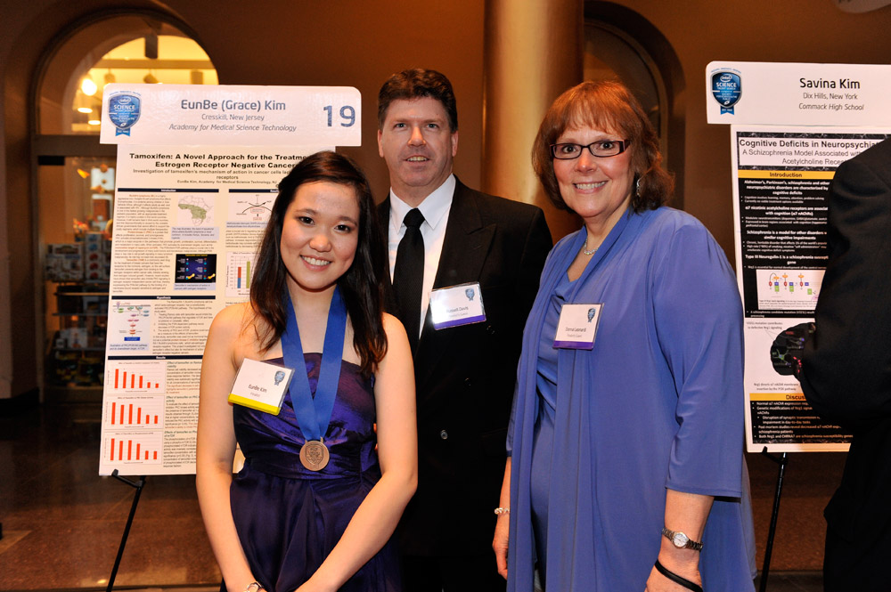 Grace Kim at the STS Awards Gala with her mentor, Donna Leonardi, and Russell Davis, principal of the Academy for Medical Science Technology.