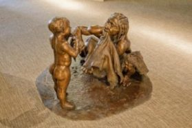 This sculpture by John Gurche shows a female Neandertal teaching her child how to poke holes in animal hide. Sculpture: credit: 2010, John Gurche; Photo: Chip Clark, Smithsonian Institution