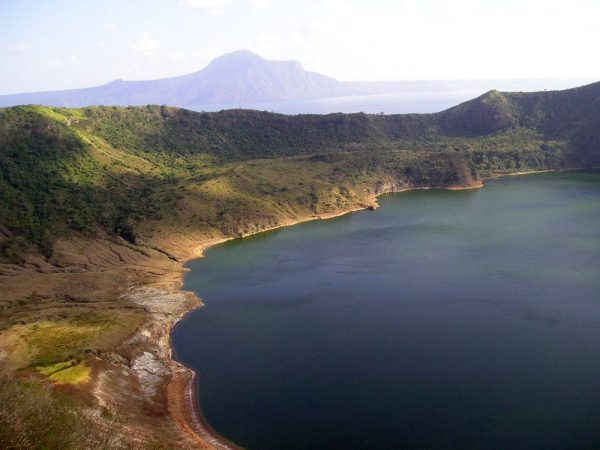 A lake sits in the crater of the Philippine's Taal volcano. Scientists recently discovered that hot springs flowing into the lake come from a shallow source — the lake itself. Credit: MatthieuG/Wikimedia Commons