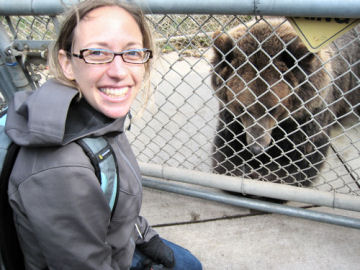 Science News for Kids reporter Emily Sohn gets up close and personal with a grizzly bear at the WSU Bear Center.