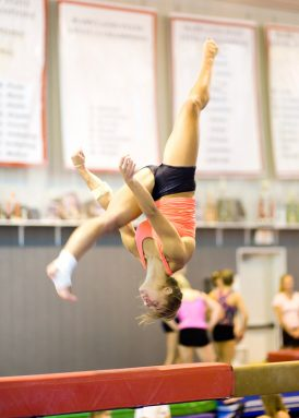By reviewing high-speed videos of a gymnast's performance, sports scientists can analyze how an athlete sails through the air — and then sticks a landing. Carefully watching a particular athlete's technique can lead to suggestions, such as jumping a moment sooner or shifting the body's weight a tad more in one direction. Credit: iStockphoto