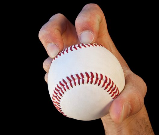 This photo shows how a knuckleball pitcher holds the ball. A knuckleball is a pitch that spins little, if at all. As a result, it seems to wander to home plate — and it's hard both to hit and to catch. Credit: iStockphoto