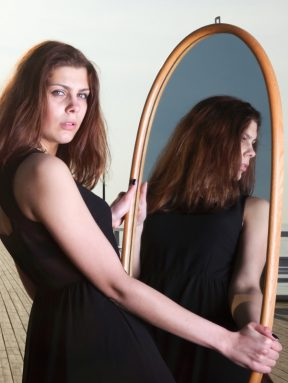 girl looking mirror