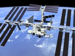 The International Space Station, illustrated here, is about the width and length of a football field. Shuttles often delivered astronauts, supplies and tools to the station.