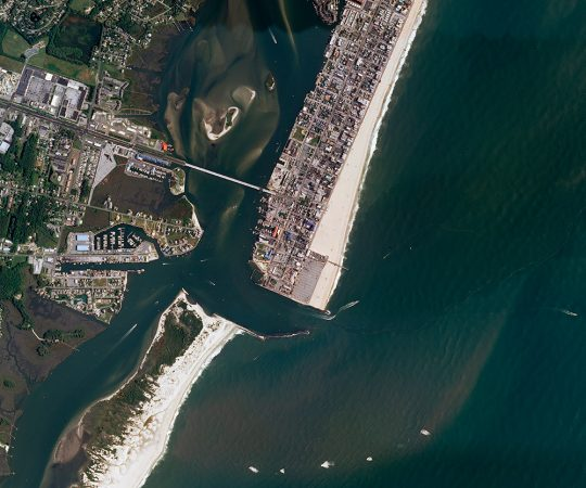 A 1933 hurricane hit the East Coast of the United States. It created a breach in Assateague Island. The new channel cut off Ocean City, Md., (at right) from the rest of the barrier island. Left largely wild and undeveloped, Assateague (at left) has steadily shifted closer to shore. Credit: USGS/Nat'l Map/Nat'l Agric'l Imagery Prog.
