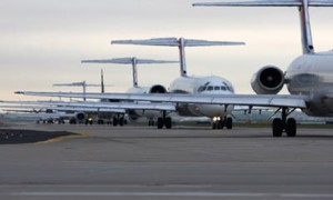 Planes await takeoff at Hartsfield-Jackson Atlanta International Airport, one of the busiest in the world. Researchers recently found that sunlight worsens the pollution from idling planes.