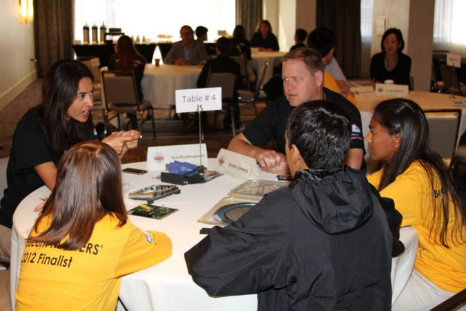 Engineers Shane Lansing and Rozi Roufoogaran flew across the country to talk with young researchers in Washington, D.C., about careers in engineering. Both work at Broadcom, the company that sponsors the MASTERS competition. Credit: