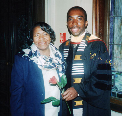 a photo from 1999 of Edray Goins and his mother celebrating graduating with his PhD in mathematics