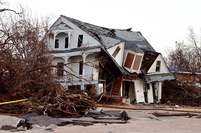 a photo of a destroyed beach house