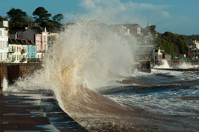 a wave breaking on a seawall