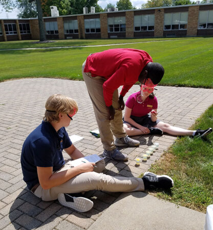 students outside doing a bubble lab experiment
