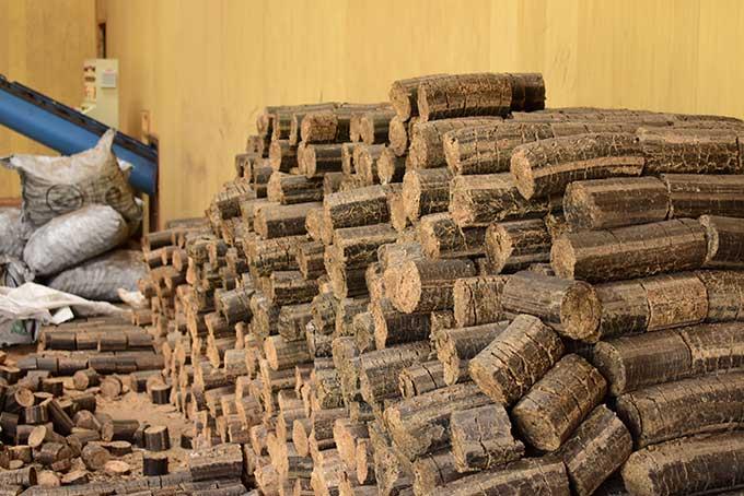 a pile of brown briquettes