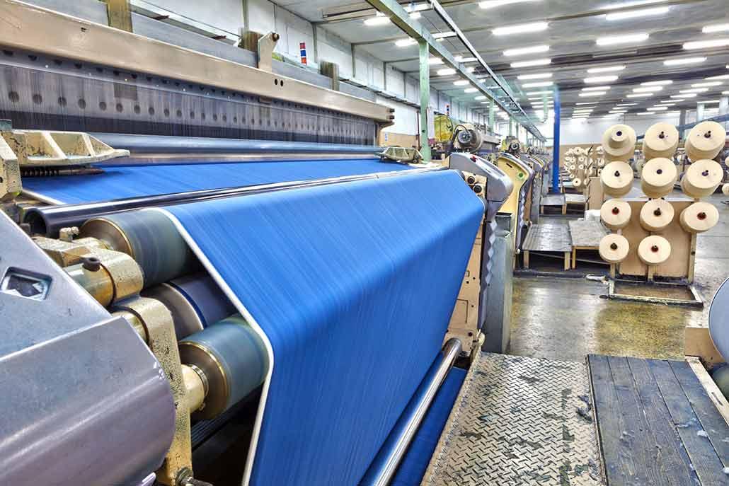a photo of a factory weaving denim
