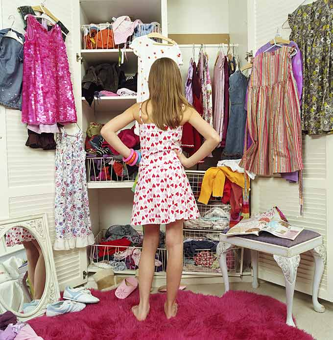 a photo of a teen looking at a closet