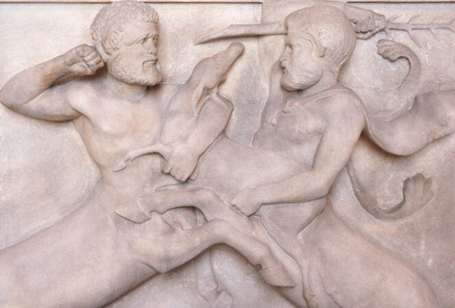 two centaurs fighting carveed into stone