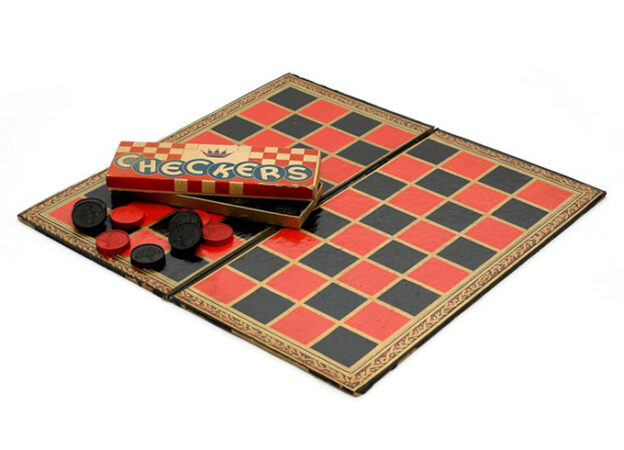 a photo of a checkers board and checkers pieces
