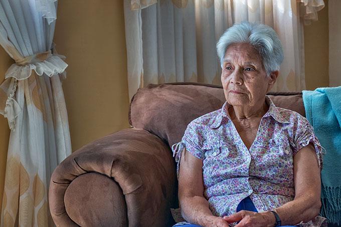 an senior Venezualan woman sitting on a sofa