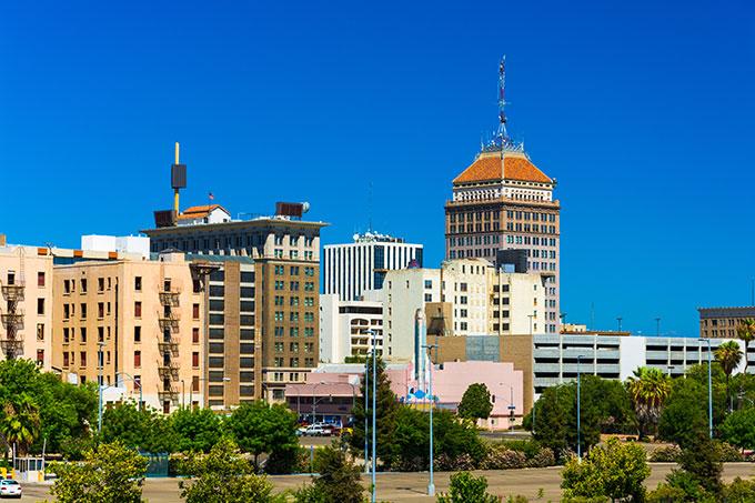 a photo of Fresno, CA under a very blue sky