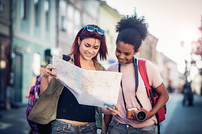 two girls looking at a map
