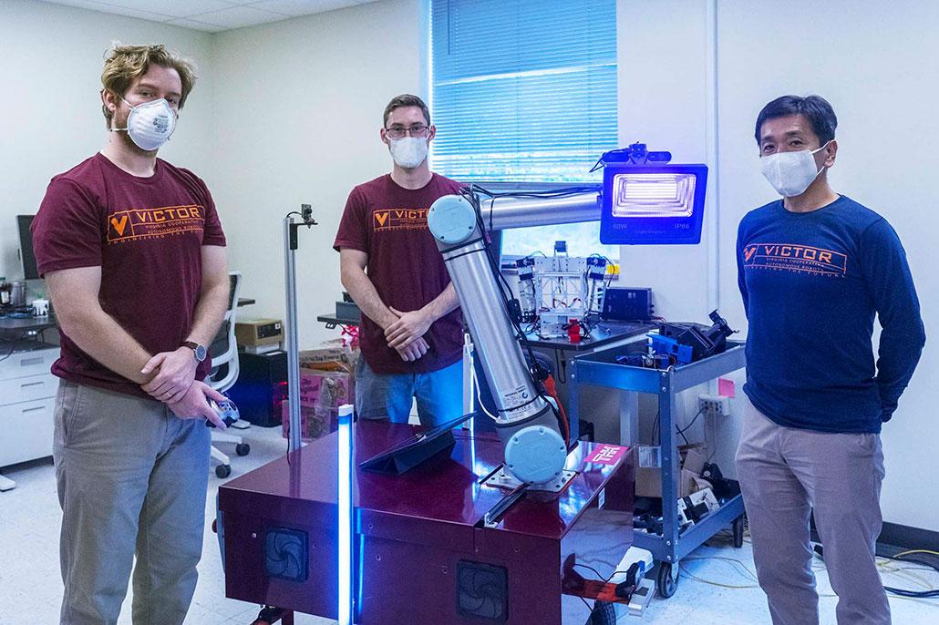 a photo of three robotics engineers with DINGO