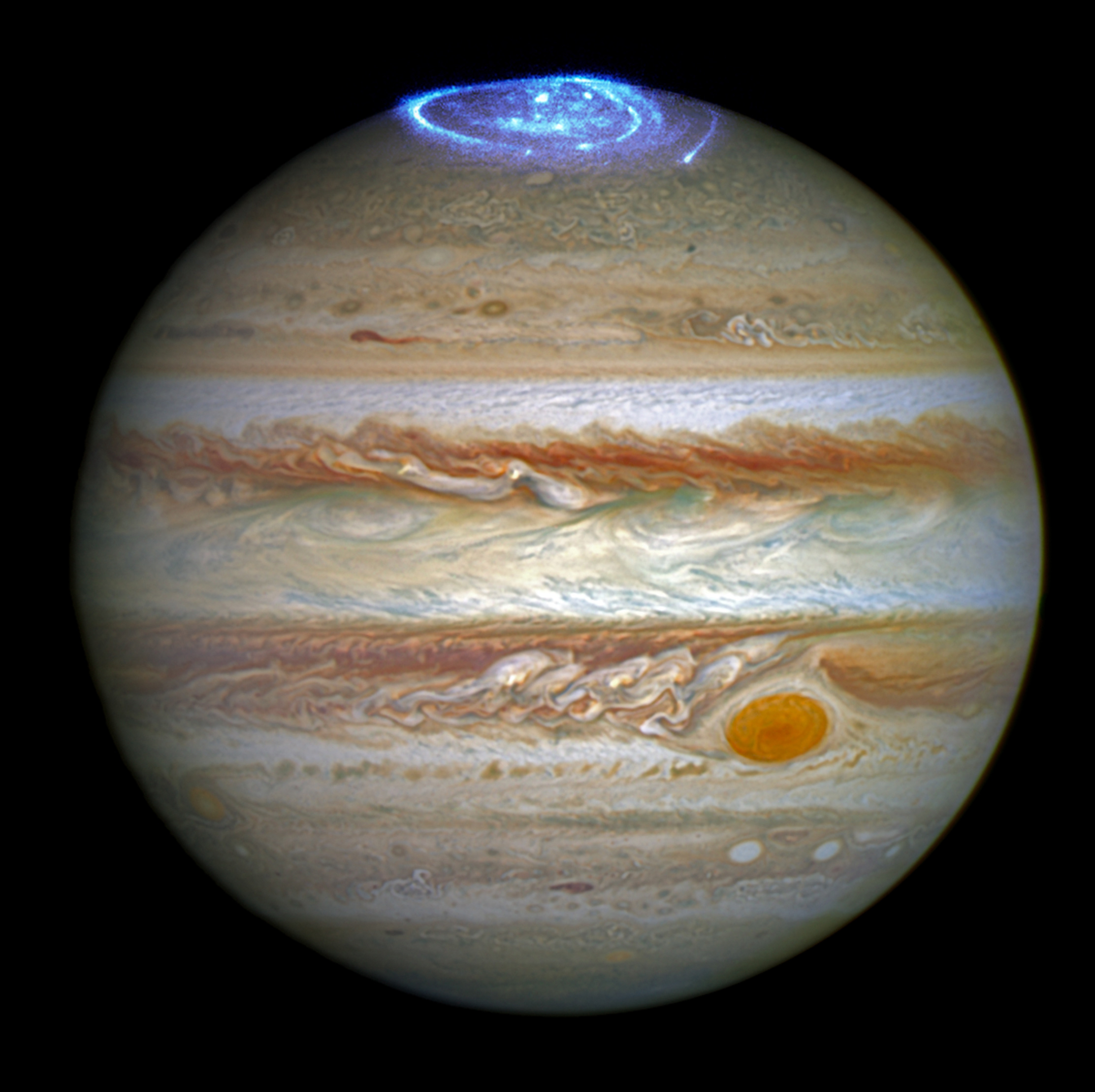 telescope images of Jupiter show ultraviolet auroras in blue over the planet's north pole