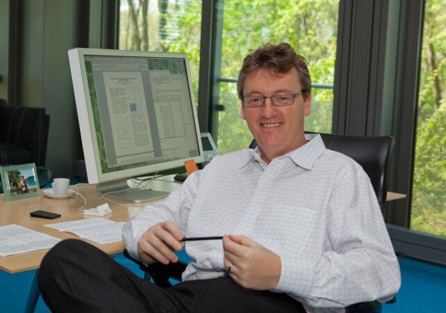 David MacMillan sitting in his office